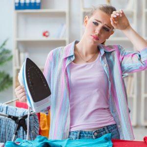 sad-woman-ironing-clothing-at-home-9-1146191
